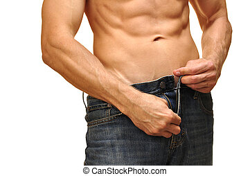 Unzip jeans - Sexy man with lean abdominals unzips his jeans...
