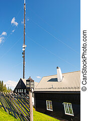 Communication tower from a rural landscape in Scamdinavia -...