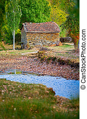 water mill - antique water mill and dry river, shallow depth...