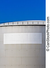 Oil reservoir on a petrochemical plant with white label