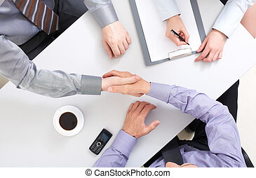 Agreement - Above view of businessmen doing agreement at...