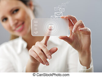 Beautiful woman is typing a mail on her innovative...