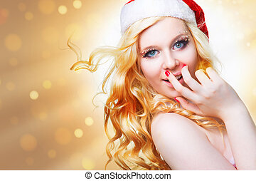 beautiful sexy girl wearing santa claus clothes on golden...