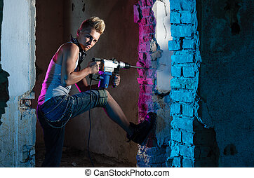 Manhood - Attractive worker holding a drill in his hands