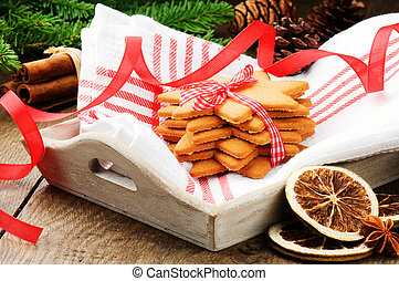 Christmas gingerbread cookies in festive setting next to fir...