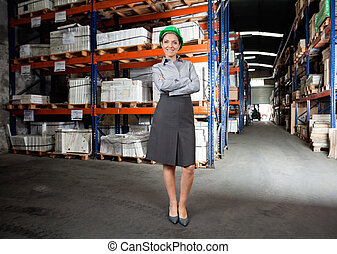 Confident Female Supervisor At Warehouse