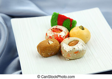 Juicy sweets of India - Assorted colorful sweets of India