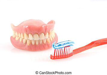 Dental care - Dentures and toothbrush with toothpaste...