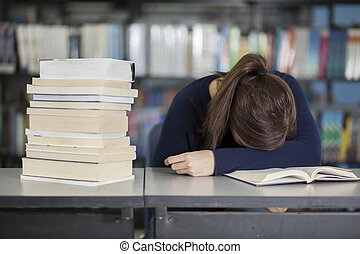 Tired of studying at the library - Female college student...