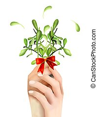 Hand Hoding Green Mistletoe with A Red Bow