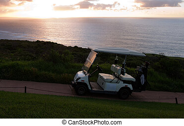 Golf cart at seaside holiday resort - Golf cart at beach or...