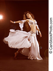 Belly dancer, beautiful brunette woman Sexy Arabian oriental...
