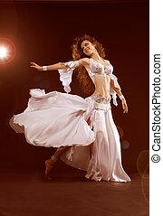 Belly dancer, beautiful brunette woman. Sexy Arabian...