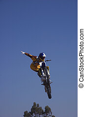 Moto X Freestyle 9 - Moto X Freestyle rider high in sky with...