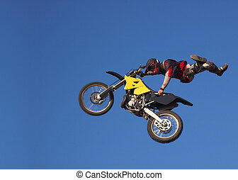 Moto X Freestyle 3 - Moto X Freestyle rider jumps high in...