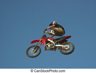 Moto X Freestyle 4 - Moto X Freestyle rider high in sky with...