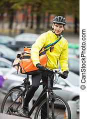 Male Cyclist With Courier Delivery Bag On Street - Portrait...