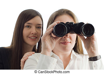 Business women with binoculars - Two business woman...