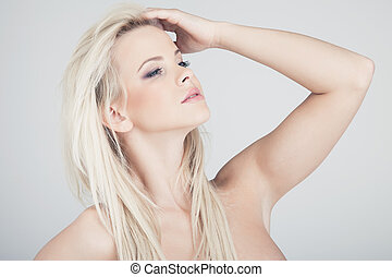 Over a shoulder - Young blond lady with a beautiful hair on...