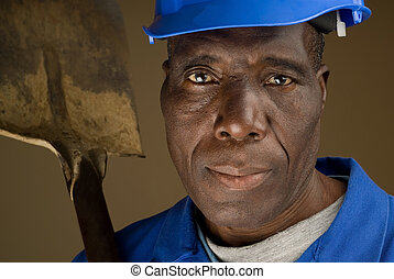 Construction Worker Resting Shovel on Shoulder