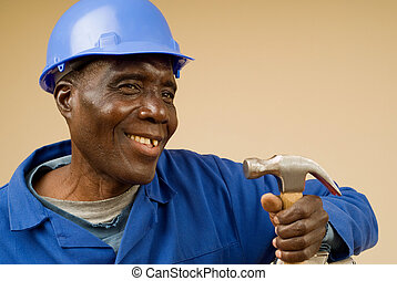 Construction Worker Holding Hammer - Smiling African...