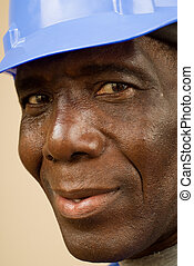 Construction Worker Portrait - Close up of happy african...