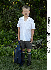 Sad at first day of school - Schoolboy sad or unhappy at...
