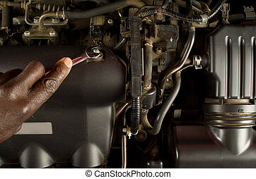 Fixing car engine - South African or American mechanic hand...