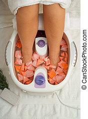 Feet in spa massage bath - Womens feet in massage spa bath...