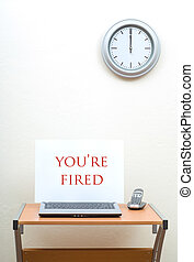 You're Fired - Office desk with you're fired sign on open...