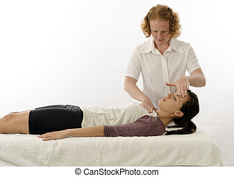 Kinesiologist treating neck muscles - Kinesiologist or...