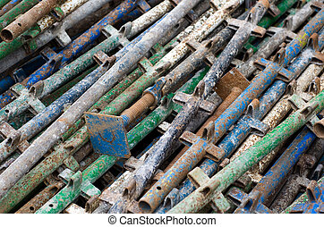 Scaffold and construction suppport - Pile of old...