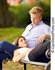 Young Woman Lying on Her Boyfriend's Lap