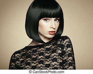 Fashion portrait of a young beautiful dark-haired woman...