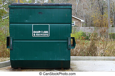 A large green disposal and recycling dumpster parked outside...