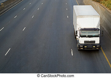 White truck on highway - White big delivery or logistics...