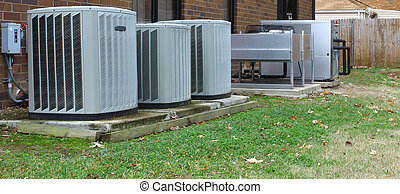 A group of three industrial air conditioners and equipment...