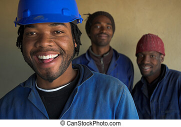 Smiling construction workers - Three smiling building,...