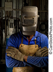 African welder with mask - South African or American welder...