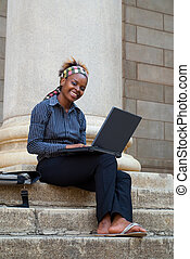 African American College Student with laptop - African...