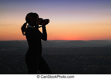 Silhouette of Business Woman with Binoculars Standing on a...