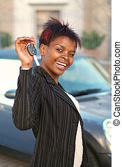 New car - African American businesswoman happy with keys to...