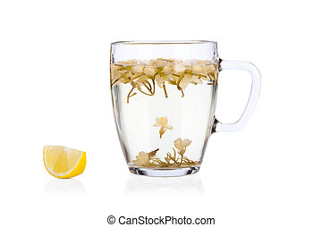 Hot jasmine tea with flowers and lemon isolated on white background