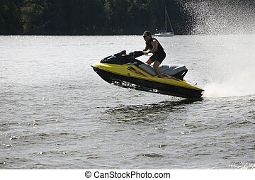 Jetbike rushes on waves with big speed so sparks fly
