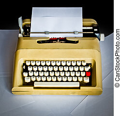 old typewriter with white pages