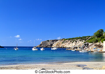 Cala Vadella beach in Ibiza, Spain - Landscape of Cala...