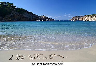 The word Ibiza written in the sand in Cala Vadella beach in...