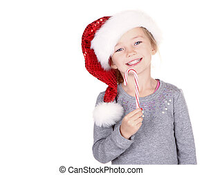 Girl wearing a santa hat holding a candy cane isolated on...