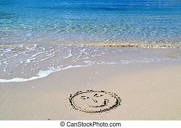 Smile face written in the sand in the beach in Cala Vadella...
