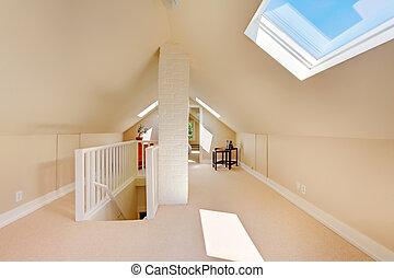 Bright clean attic in the small home.